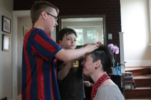 My boys, getting one last touch in of the mohawk.